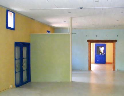 a cascade of colorful rooms seen through mulitple doorways